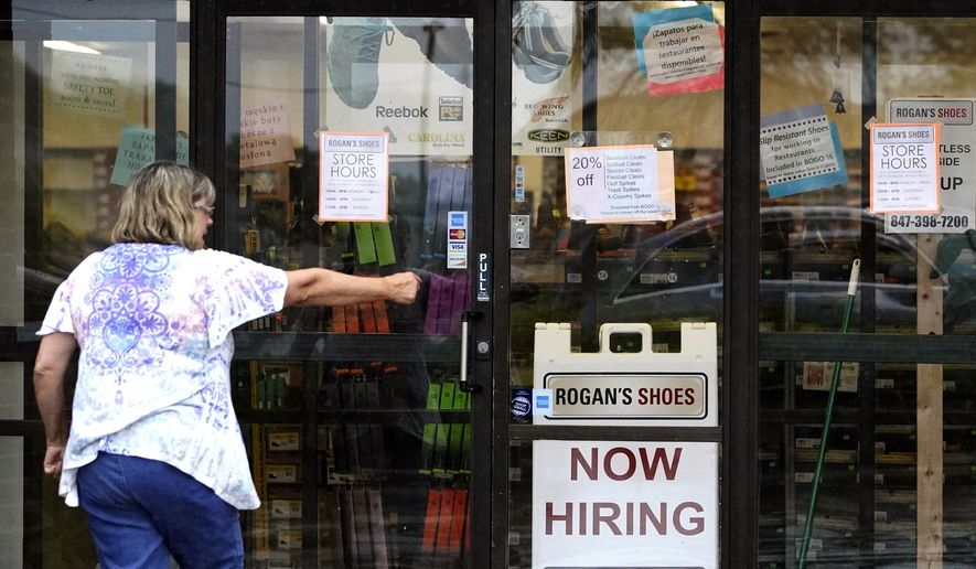 A hiring sign is displayed outside a retail store in Buffalo Grove, Ill., Thursday, June 24, 2021. (AP Photo/Nam Y. Huh) ** FILE **