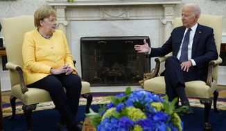 President Joe Biden meets with German Chancellor Angela Merkel in the Oval Office of the White House, Thursday, July 15, 2021, in Washington. (AP Photo/Evan Vucci)