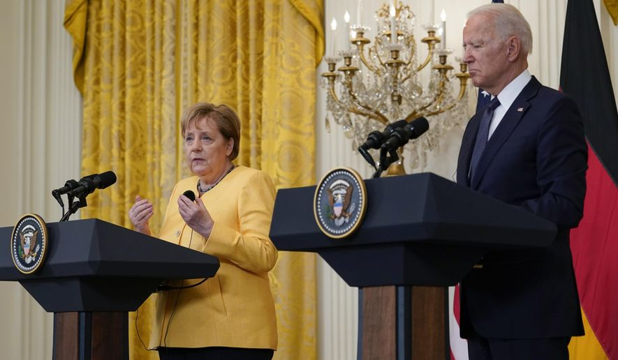 President Joe Biden and German Chancellor Angela Merkel speak during a news conference in the East Room of the White House in Washington, Thursday, July 15, 2021. (AP Photo/Susan Walsh)