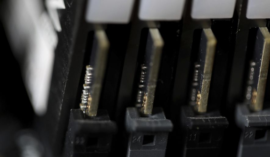 This Feb 23, 2019, photo shows the inside of a computer in Jersey City, N.J. The Biden administration will offer rewards up to $10 million for information leading to the identification of foreign state-sanctioned malicious cyber activity against critical U.S. infrastructure, including ransomware attacks. The administration is launching the website stopransomware.gov to offer the public resources for countering the threat. (AP Photo/Jenny Kane) **FILE**