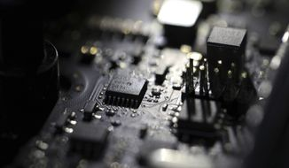This Feb 23, 2019, photo shows the inside of a computer. The Biden administration will offer rewards up to $10 million for information leading to the identification of foreign state-sanctioned malicious cyber activity against critical U.S. infrastructure, including ransomware attacks. The administration is launching the website stopransomware.gov to offer the public resources for countering the threat. (AP Photo/Jenny Kane) **FILE**