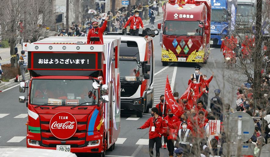 FILE - In this March 28, 2021, file photo, Olympic sponsors' vehicles parade ahead of torch relay in Ashikaga, Tochigi prefecture, north of Tokyo. The Olympic corporate sponsorship program has been a key part of the Olympic experience since it began in 1985. But all that magic from the Olympic sponsorship is being undermined because of the virus.  (Shinji Kita/Kyodo News via AP, File)