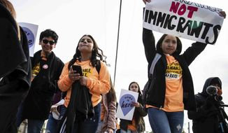 Immigrant youth and advocates rally to the office of Attorney General Ken Paxton on the day of the Supreme Court's hearing on DACA in Austin, Texas, in this July 2019 file photo. (Lola Gomez/Austin American-Statesman via AP, File)  **FILE**