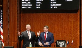 In this March 9, 2020, file photo, Louisiana House Speaker Clay Schexnayder, R-Gonzalez, left, and Senate President Page Cortez, R-Lafayette, react after Cortez broke Schexnayder's gavel for the opening of the 2020 general legislative session in Baton Rouge, La. Louisiana lawmakers will hold their first veto session under the state's nearly 50-year-old constitution. The session will open Tuesday, July 20, 2021, and last up to five days.  (AP Photo/Gerald Herbert, File)