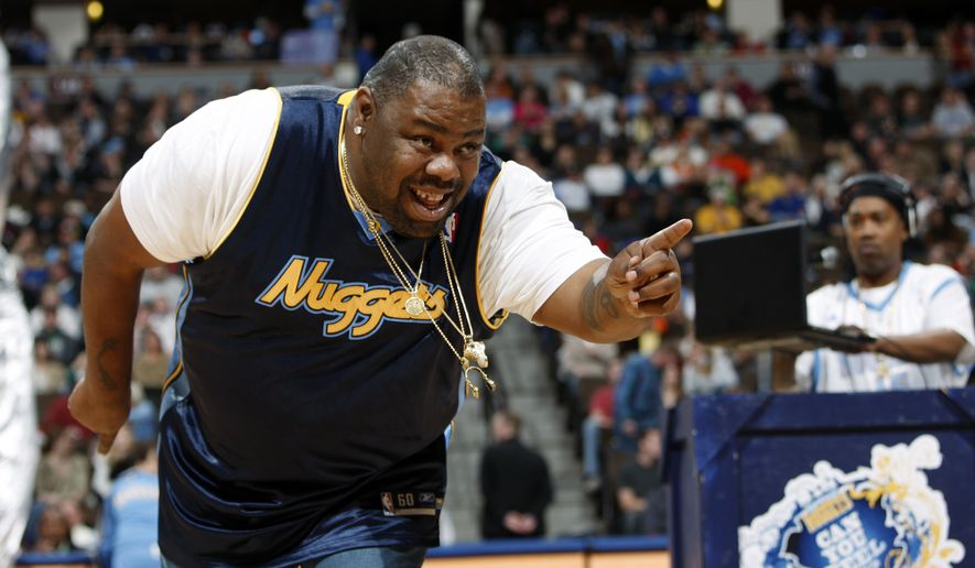 """Biz Markie performs for fans during halftime of the Denver Nuggets' 105-99 victory over the Phoenix Suns in an NBA basketball game in Denver on Dec. 12, 2009. The hip-hop staple known for his beatboxing prowess, turntable mastery and the 1989 classic """"Just a Friend,"""" has died. He was 57. Markie's representative, Jenni Izumi, said in a statement that the rapper-DJ died peacefully Friday, July 16, 2021, with his wife by his side. No cause of death was released. (AP Photo/David Zalubowski)  **FILE**"""