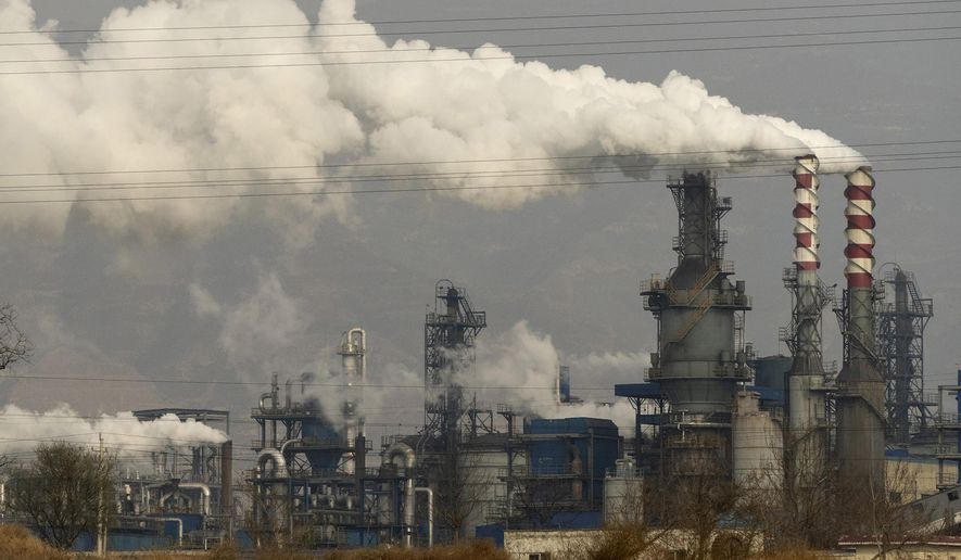 FILE - In this Nov. 28, 2019, file photo, smoke and steam rise from a coal processing plant in Hejin in central China's Shanxi Province. Chinese power companies bid for credits to emit carbon dioxide and other climate-changing gases as trading on the first national carbon exchange began Friday, July 16, 2021 in a step meant to help curb worsening pollution. (AP Photo/Olivia Zhang, File)