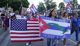 Demonstrators shout their solidarity with the Cuban people against the communist government, Thursday, July 15, 2021, in Hialeah, Fla. Hialeah has the greatest concentration of Cuban exiles in the U.S. (AP Photo/Marta Lavandier)
