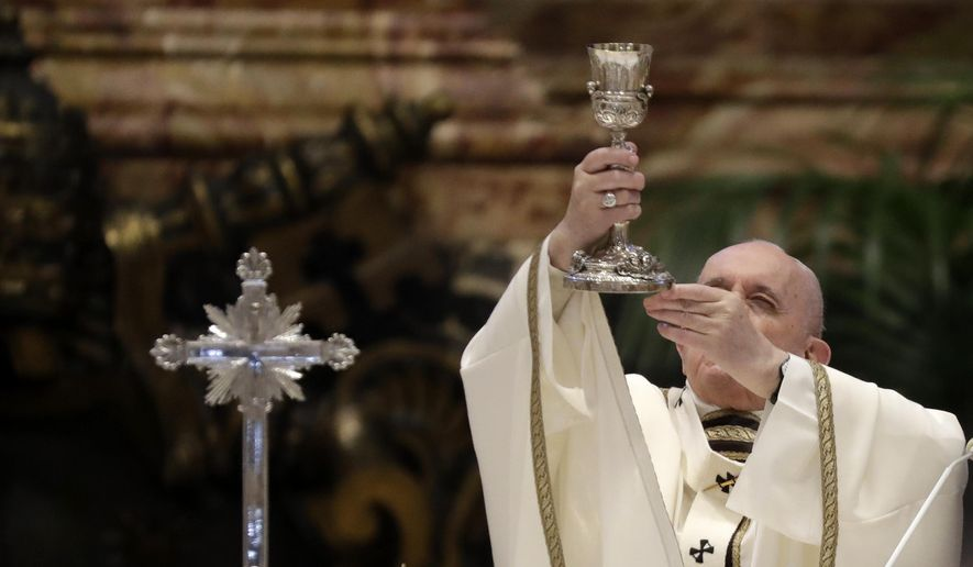 in this Thursday, April 1, 2021, file photo, Pope Francis celebrates a Chrism Mass inside St. Peter's Basilica, at the Vatican. During the Mass the Pontiff blesses a token amount of oil that will be used to administer the sacraments for the year. Pope Francis cracked down on the spread of the old Latin Mass on Friday, July 16, 2021, reversing one of Pope Benedict XVI's signature decisions in a major challenge to traditionalist Catholics. (AP Photo/Andrew Medichini)