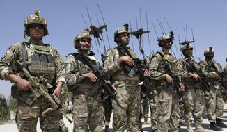 Newly Afghan Army Special forces attend their graduation ceremony after a three-month training program at the Kabul Military Training Centre (KMTC) in Kabul, Afghanistan, Saturday, July 17, 2021. (AP Photo/Rahmat Gul)
