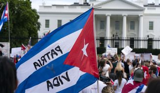 Demonstrators shout their solidarity with the Cuban people against the communist government during a rally outside the White House in Washington, Saturday, July 17, 2021.(AP Photo/Jose Luis Magana)
