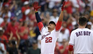 Washington Nationals' Juan Soto (22) celebrates his two-run home run during the eighth inning of the team's baseball game against the San Diego Padres, Sunday, July 18, 2021, in Washington. The Nationals won 8-7. (AP Photo/Nick Wass)