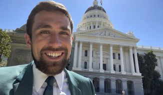 In a photo provided by Kevin Paffrath, Kevin Paffrath smiles for a selfie in front of the California State Capitol in Sacramento on Friday, July 16, 2021. The 29-year-old YouTuber is one of the Democrats running in the recall against California Gov. Gavin Newsom. Paffrath's videos typically touch on real estate and investment advice, and he's never held public office. (Kevin Paffrath via AP)