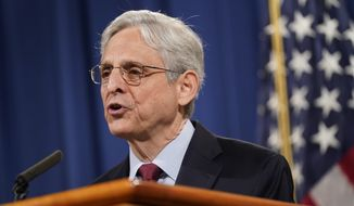 In this June 25, 2021, file photo, Attorney General Merrick Garland speaks during a news conference on voting rights at the Department of Justice in Washington. Garland has formally prohibited federal prosecutors from seizing the records of journalists in leak investigations. Garland's directive Monday reverses years of department policy. (AP Photo/Patrick Semansky/File)