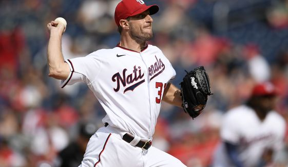 Washington Nationals starting pitcher Max Scherzer delivers a pitch during a baseball game against the San Diego Padres, Sunday, July 18, 2021, in Washington. (AP Photo/Nick Wass)
