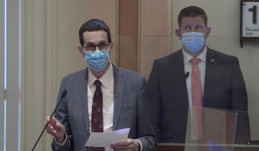 State Sen. Scott Wiener, D-San Francisco, wears a face mask as he speaks on the floor of the Senate in Sacramento, Calif., Thursday, July 15, 2021. Gay rights advocates said Monday, July 19, 2021 that they will seek to challenge an appeals court decision tossing out part of a California law designed to protect older LGBTQ residents in nursing homes. (AP Photo/Rich Pedroncelli)