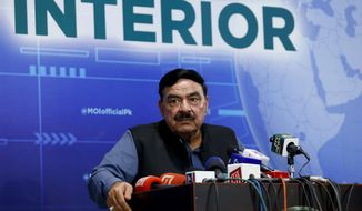Pakistan's Interior Minister Sheikh Rashid Ahmad gives a press conference regarding the abduction of the daughter of Afghan ambassador to Pakistan, in Islamabad, Pakistan, Sunday, July 18, 2021. The daughter of Afghanistan's ambassador to Pakistan was abducted in the middle of the Pakistani capital of Islamabad, held for several hours and brutally attacked, officials in both countries said. (AP Photo/Anjum Naveed)