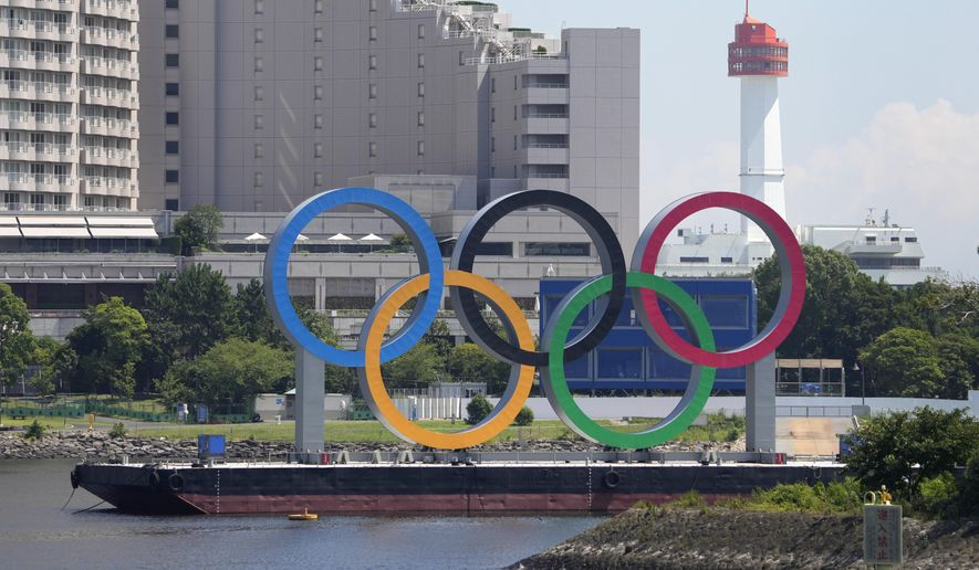 The Olympic rings float on a barge ahead of the 2020 Summer Olympics, Monday, July 19, 2021, in Tokyo. (AP Photo/Charlie Riedel)