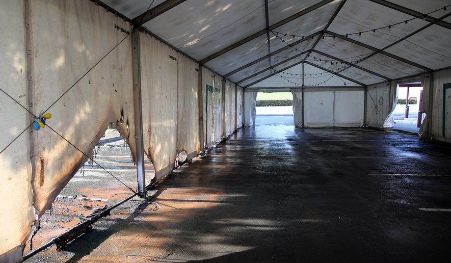 A view of the empty tent of a vaccination center after an arson attack on Saturday evening in Urrugne, southwestern France, Monday, July 19, 2021. Two COVID-19 vaccination centers were ransacked in less than 48 hours in France, over the weekend. (AP Photo/Bob Edme)