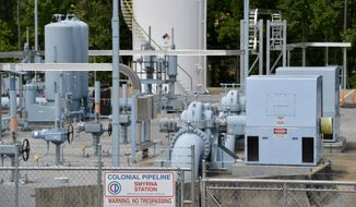 In this May 11, 2021, file photo, a Colonial Pipeline station is seen in Smyrna, Ga., near Atlanta. The Department of Homeland Security has announced new requirements for U.S. pipeline operators to bolster cybersecurity following a May ransomware attack that disrupted gas delivery across the East Coast. (AP Photo/Mike Stewart) ** FILE **