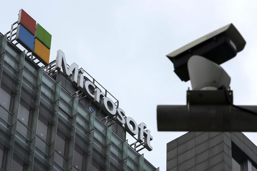 A security surveillance camera is seen near the Microsoft office building in Beijing, Tuesday, July 20, 2021. The Biden administration and Western allies formally blamed China on Monday for a massive hack of Microsoft Exchange email server software and asserted that criminal hackers associated with the Chinese government have carried out ransomware and other illicit cyber operations. (AP Photo/Andy Wong)