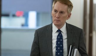 Sen. James Lankford, R-Okla., arrives for a hearing on Capitol Hill, Tuesday, June 8, 2021, in Washington. Lankford,  whose voting record in the Senate has aligned with former President Donald Trump's position nearly 90% of the time, finds himself under fierce attack by a challenger in his own party. Similar scenes are playing out in other red states where ultra right-wing challengers are tapping into anger among Republicans over Trump's election loss and coronavirus-related lockdowns. (AP Photo/Alex Brandon) **FILE**