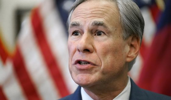 In this Tuesday, June 8, 2021, photo, Texas Gov. Greg Abbott speaks at a news conference in Austin, Texas. Abbott, who faces a contested reelection primary next year, is pushing looser gun laws than he ever previously embraced and proposing unprecedented state actions, including promises to build more walls on the Mexican border. Similar scenes are playing out in campaigns in other red states including Arkansas and Idaho, where ultra-right-wing challengers are tapping into anger among Republicans over Trump's election loss and coronavirus-related lockdowns. (AP Photo/Eric Gay) **FILE**