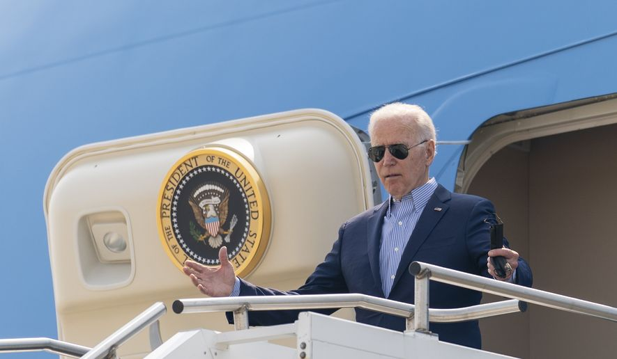 President Joe Biden arrives at Cincinnati/Northern Kentucky International Airport in Hebron, Ky., Wednesday, July 21, 2021, to travel to Cincinnati, for a town hall and to tour an electrical training center. (AP Photo/Andrew Harnik)