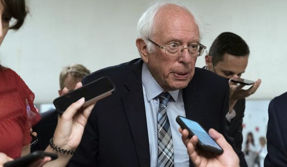 Sen. Bernie Sanders, I-Vt., talks to reporters as he walks to the Senate chamber ahead of a test vote scheduled by Democratic Leader Chuck Schumer of New York on the bipartisan infrastructure deal senators brokered with President Joe Biden, on Capitol Hill, in Washington, Wednesday, July 21, 2021. (AP Photo/Jose Luis Magana) ** FILE **