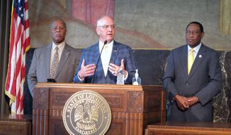 Louisiana Gov. John Bel Edwards talks to the media after Republican lawmakers failed in their effort to override any of his vetoes in a two-day legislative gathering that ended Wednesday, July 21, 2021, in Baton Rouge, La. To the left of Edwards is Senate Democratic leader Gerald Boudreaux of Lafayette, and to his right is House Democratic leader Sam Jenkins of Shreveport. (AP Photo/Melinda Deslatte) SLUG: BC-LA-XGR--Louisiana Veto Session