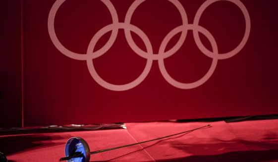 An epee is left next to a fencing piste at the Makuhari Messe fencing arena during equipment tests ahead of the 2020 Summer Olympics, Wednesday, July 21, 2021, in Tokyo, Japan. (AP Photo/Andrew Medichini)