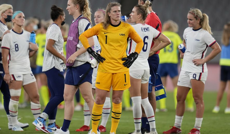 United States' goalkeeper Alyssa Naeher, center, reacts at the end of a women's soccer match against Sweden at the 2020 Summer Olympics, Wednesday, July 21, 2021, in Tokyo. Sweden won 3-0. (AP Photo/Ricardo Mazalan)