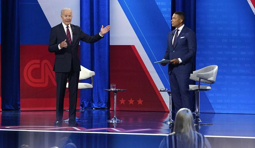 President Joe Biden, accompanied by CNN journalist Don Lemon, right, speaks at CNN town hall at Mount St. Joseph University in Cincinnati, Wednesday, July 21, 2021. (AP Photo/Andrew Harnik)