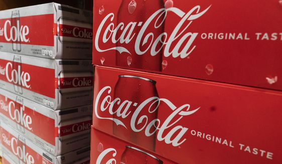 Cases of Coca-Cola are displayed in a supermarket, Monday, April 5, 2021, in New York. (AP Photo/Mark Lennihan) ** FILE **