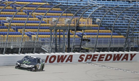 A car makes a lap at Iowa Speedway, Tuesday, May 6, 2014, in Newton, Iowa.  (AP Photo/Charlie Neibergall)