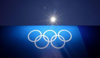 The Olympic rings are seen at Yokohama Baseball Stadium as the venue is prepared for softball competition at the 2020 Summer Olympics, Thursday, July 22, 2021, in Yokohama, Japan. (AP Photo/Matt Slocum)