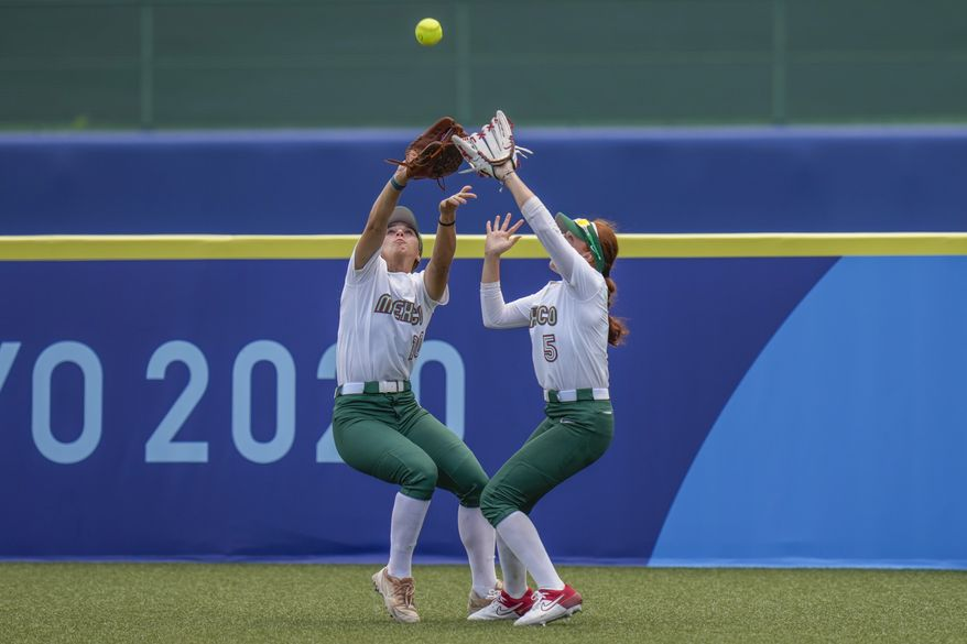 Mexico's Nicole Rangel, left, and Suzannah Brookshire collide as they attempt to take a catch during the softball game between the Mexico and Japan at the 2020 Summer Olympics, Thursday, July 22, 2021, in Fukushima , Japan. (AP Photo/Jae C. Hong)