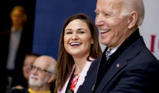 In this Friday, Jan. 3, 2020 file photo, Democratic presidential candidate Joe Biden, right, and Rep. Abby Finkenauer, D-Iowa, center, smile during a campaign rally at the University of Dubuque, in Dubuque, Iowa. Iowa Democrat Abby Finkenauer is running for Republican Chuck Grassleys U.S. Senate seat. The one-term former congresswoman hopes her blue-collar credentials will propel her forward in a state that has grown more conservative over the years.  (AP Photo/Andrew Harnik)  ** FILE **