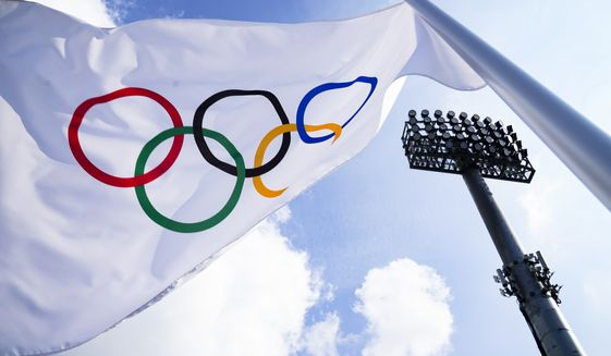 A flag bearing the Olympic Rings is displayed on the south pitch during field hockey practices at the 2020 Summer Olympics, Friday, July 23, 2021, in Tokyo, Japan. (AP Photo/John Minchillo)
