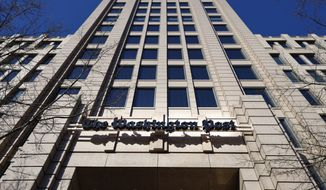 This Feb. 8, 2019, file photo shows The One Franklin Square Building, home of The Washington Post, in downtown Washington. Washington Post politics reporter Felicia Sonmez sued the paper and several of its current and former editors for discriminating against her as a victim of sexual assault. In a suit filed Wednesday, July 21, 2021, in D.C. Superior Court, Sonmez says she was not allowed to report on sexual misconduct and frequently taken off stories after she publicly spoke out about her own experience. (AP Photo/Pablo Martinez Monsivais, File )