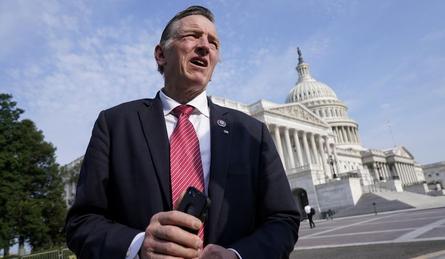 Rep. Paul Gosar, R-Ariz., a dentist, waits to join House Minority Whip Steve Scalise, R-La., and members of the GOP Doctors Caucus, for a news conference about the Delta variant of COVID-19 and the origin of the virus, at the Capitol in Washington, Thursday, July 22, 2021. (AP Photo/J. Scott Applewhite)