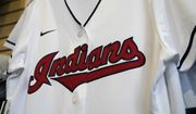 A Cleveland Indians jersey hangs at the Cleveland Indians team shop in Cleveland, in this Wednesday, Dec. 16, 2020, file photo. Known as the Indians since 1915, Cleveland's Major League Baseball team will be called Guardians. The ballclub announced the name change Friday, July 23, 2021, with a video on Twitter narrated by actor Tom Hanks, ending months of internal discussions triggered by a national reckoning by institutions and teams to permanently drop logos and names considered racist. (AP Photo/Tony Dejak, File)