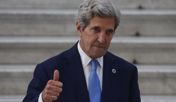 Special Presidential Envoy for Climate John Kerry gestures as he poses during a photo opportunity with Italian Minister for Ecological Transition Roberto Cingolani, at Palazzo Reale in Naples, Italy, Friday, July 23, 2021, where a G20 meeting on environment, climate and energy is under way. (AP Photo/Salvatore Laporta)