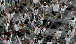 Athletes of Germany celebrate as they are introduced during the opening ceremony at the Olympic Stadium at the 2020 Summer Olympics, Friday, July 23, 2021, in Tokyo. (AP Photo/Morry Gash)