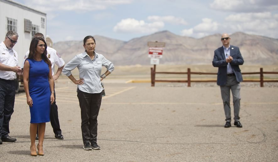 Interior Secretary Deb Haaland, right, stands with U.S. Rep. Lauren Boebert, R-Colo., while touring the Grand Junction Air Center complex, a multi-purpose wildland fire management and operation center, Friday, July 23, 2021, in Grand Junction, Colo. (McKenzie Lange/The Grand Junction Daily Sentinel via AP)