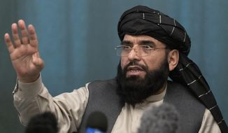 In this March 19, 2021, file photo, Suhail Shaheen, Afghan Taliban spokesman and a member of the negotiation team, gestures while speaking during a joint news conference in Moscow, Russia. In an interview with The Associated Press Thursday, July 22, 2021, Shaheen said the insurgent movement does not want to monopolize power, but there won't be peace until there is a new, negotiated government in Kabul and Afghan President Ashraf Ghani is removed. Shaheen said women will be allowed to work, go to school and participate in politics but will have to wear the hijab or headscarf. (AP Photo/Alexander Zemlianichenko, Pool, File)
