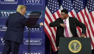 In this Sept. 25, 2020, file photo, President Donald Trump elbow bumps with Herschel Walker during a campaign rally in Atlanta. (AP Photo/John Bazemore, File)  **FILE**