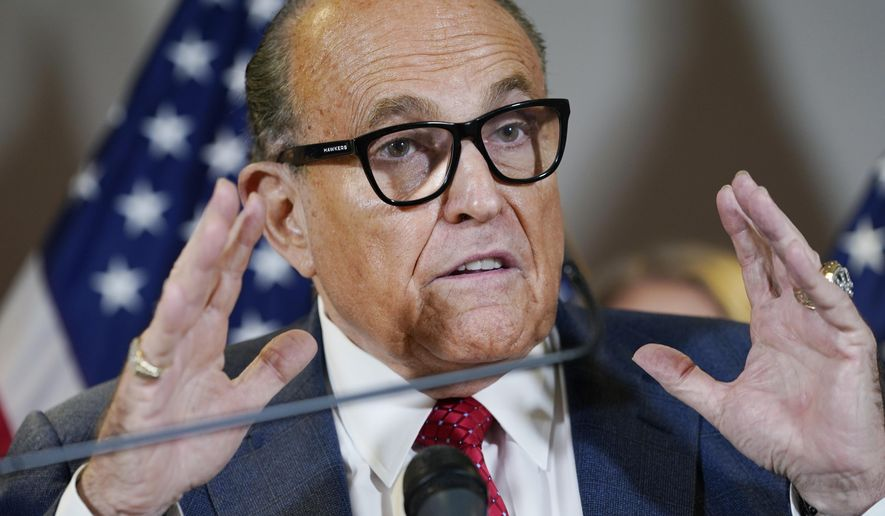 """In this Nov. 19, 2020, file photo, former New York Mayor Rudy Giuliani speaks during a news conference at the Republican National Committee headquarters in Washington. Giuliani's law license has already been suspended in his home state. That suspension, in practice, may well amount to a national suspension. A New York appeals court took the action in June, saying Giuliani's bid to discredit the election was so egregious that he poses """"an immediate threat"""" to the public. (AP Photo/Jacquelyn Martin, File)"""