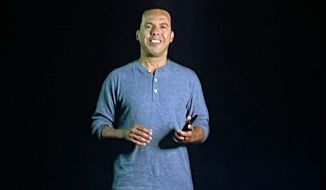 A holographic image of the Rev. Samuel Rodriguez Jr. appears to float above the platform at City Impact Church near Auckland, New Zealand, on July 4. The speaker recorded the sermon in California using technology that made the image look three-dimensional when projected. [Photo: The K Company]