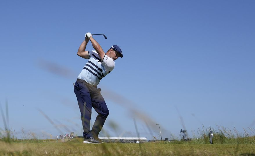 United States' Bryson DeChambeau plays his tee shot at the 9th hole during the third round of the British Open Golf Championship at Royal St George's golf course Sandwich, England, Saturday, July 17, 2021. (AP Photo/Alastair Grant)