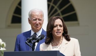 Vice President Kamala Harris speaks as President Joe Biden looks on, during an event in the Rose Garden of the White House in Washington, Monday, July 26, 2021, to highlight the bipartisan roots of the Americans with Disabilities Act and marking the law's 31st anniversary. (AP Photo/Susan Walsh) **FILE**